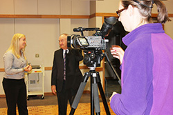 Photo of a student working a camera during an interview. Link to Life Stage Gift Planner Ages 45-65 Situations.