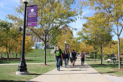 Photo of students walking on campus. Link to Gifts of Real Estate.