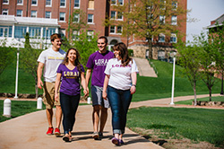 Photo of students walking on campus. Link to Gifts by Will.