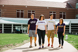 Photo of students walking on campus. Link to Gifts of Life Insurance.